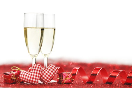 Two glasses of champagne with red decor, Valentines day concept photo