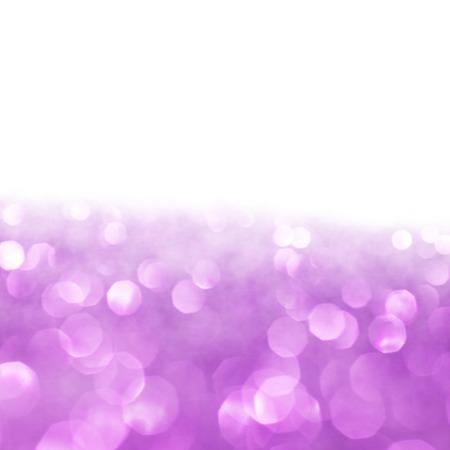 Abstract glitter bokeh holiday purple background photo