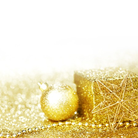Golden christmas decor and gift on glitter background with white copy space photo
