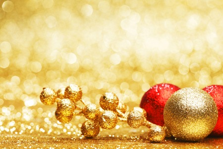Colorful christmas decoration on shiny golden background photo