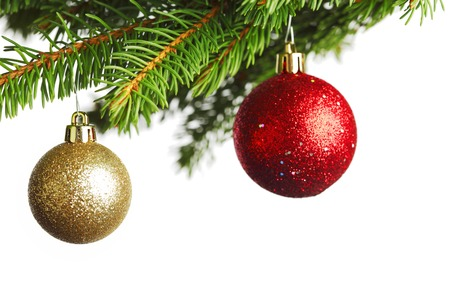 Branch of Christmas tree with red and golden glass balls isolated on white background photo