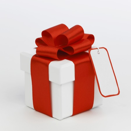 One Holiday gift with tag on white background photo