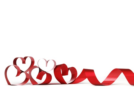 Valentines day frmae made of red ribbon hearts, isolated on white photo
