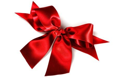 Shiny red satin ribbon decorative on white background photo