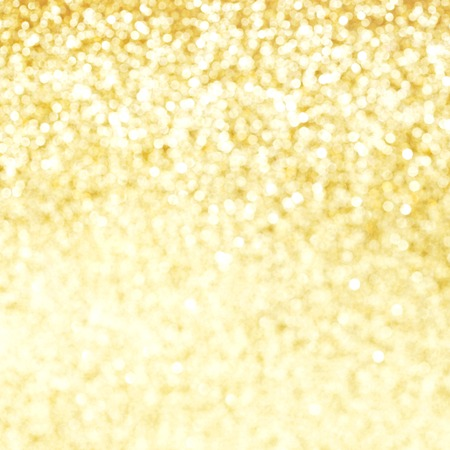 Golden festive glitter background with defocused lights photo