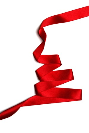 Christmas tree made of red ribbon isolated on white background photo