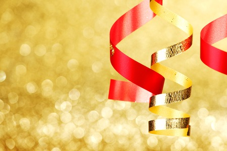 Curly gift ribbons on shiny background close-up photo