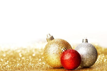 Beautiful christmas balls on abstract glitter background close-up photo