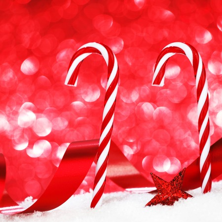 Christmas candies  on snow close-up photo
