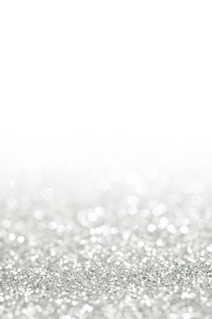 Glittery shiny lights silver abstract Christmas background Standard-Bild