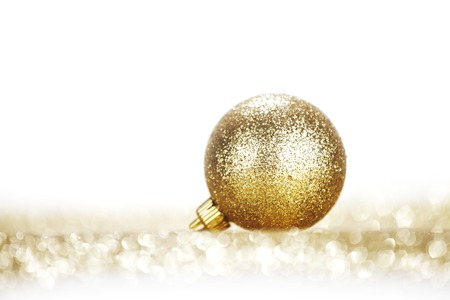 gold ornament: One chritmas ball on glitters isolated on white background Stock Photo