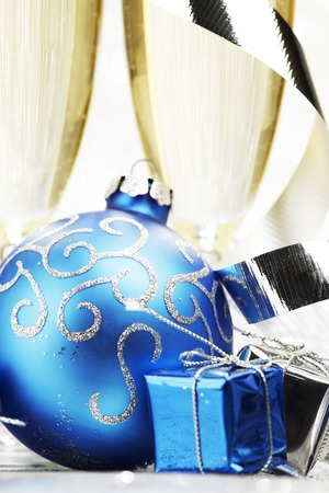 Champagne and new year decor on silver bokeh background photo