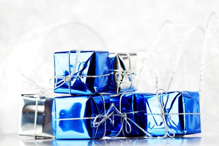 Decorative blue boxes with holiday gifts on shiny glitter background photo