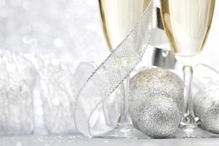 Champagne and decor on silver bokeh background photo