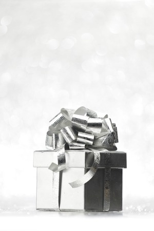 Beautiful holiday gift box decorated with silver bow photo