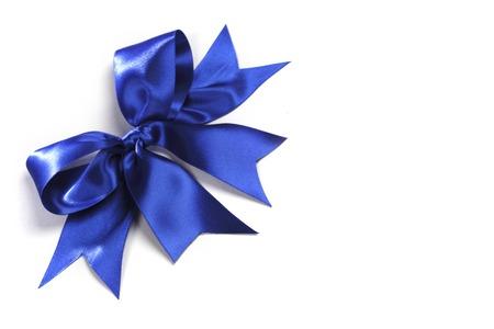 Decorative blue satin bow isolated on white background photo