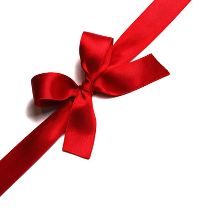 silk bow: Shiny red satin ribbon decorative on white background