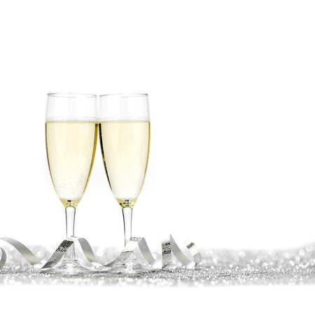 silver wedding anniversary: Two glasses of champagne with bow on silver background Stock Photo