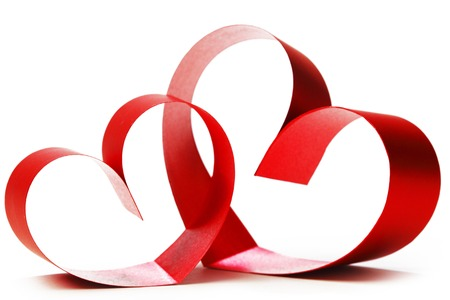 Red hearts of ribbon bow isolated on white background photo