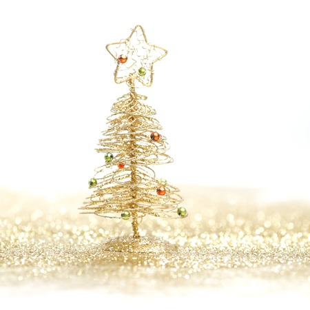 Toy small Christmas tree with decoration on white background