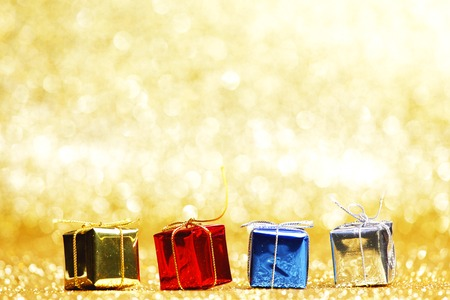 Colorful gift boxes on glitter golden background photo