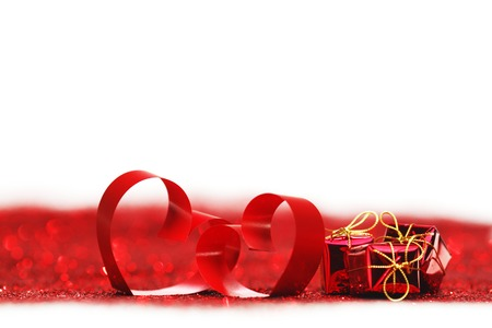Red ribbon hearts and presents on glitters isolated on white, Valentines day concept photo