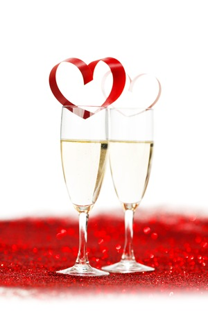 Valentines day Champagne with red glitter decoration photo
