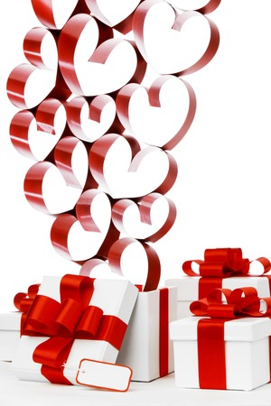 Gifts in white boxes with red ribbons and hearts isolated on white background photo