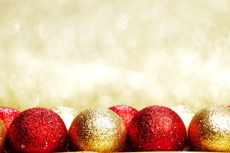 Heap of Christmas balls on golden background photo
