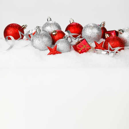Red and silver christmas balls and decoration on snow photo