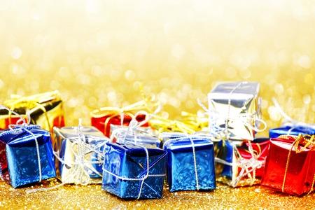 Decorative holiday colorful gift boxes on bright shiny background photo