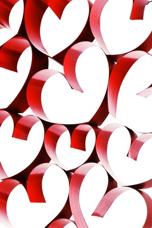 Linked red ribbon hearts isolated on white background photo