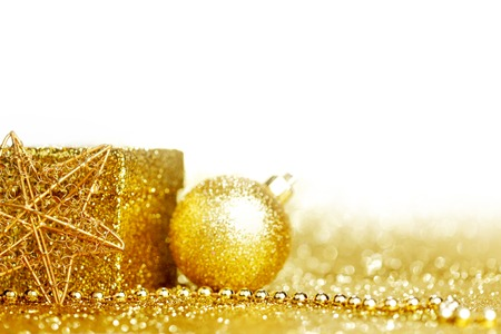 Shiny Golden christmas decor over glitter background photo
