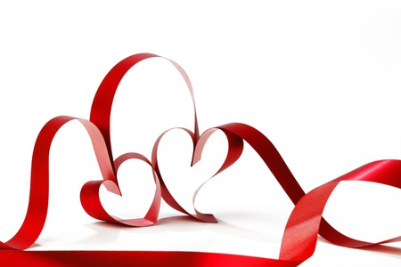 Hearts from red ribbon isolated on white background photo