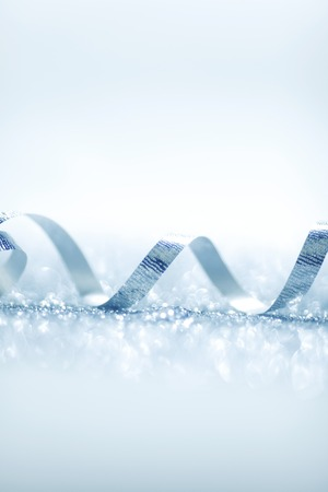 silver ribbon: Beautiful glitter silver ribbon tape curl in glitter background