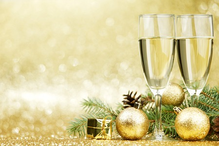Champagne and new year decorations on golden background photo