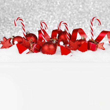 Beautiful red christmas decor on snow photo