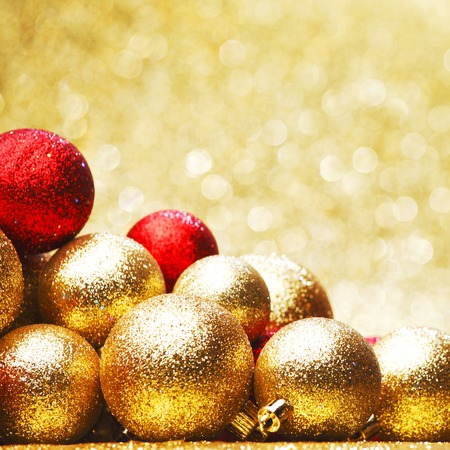 Golden Christmas ball on abstract glitter background photo