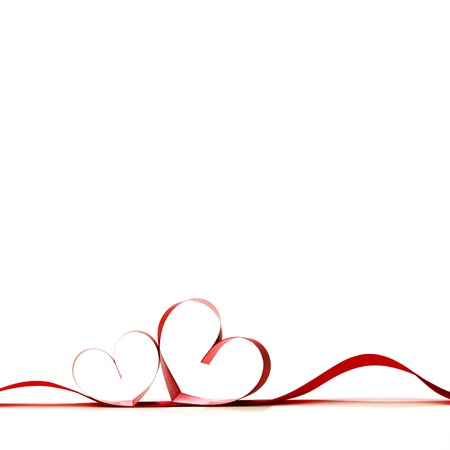 Red heart ribbon bow isolated on white background photo