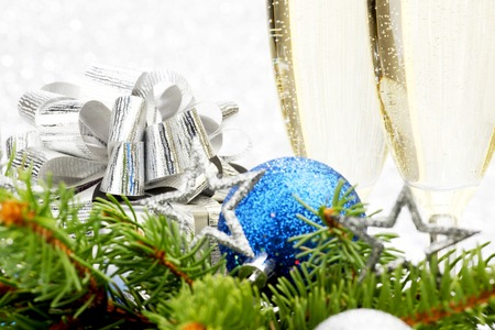 Champagne, firtree and christmas decor on light silver background photo