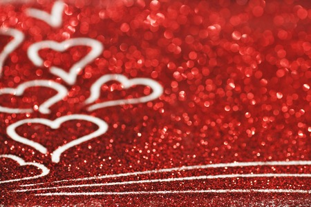 Red glitter background with hearts, valentines day design photo