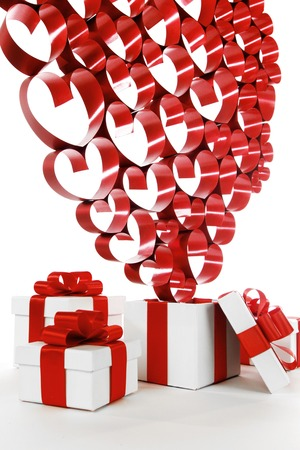 White boxes with red ribbons and decorative hearts isolated on white background photo