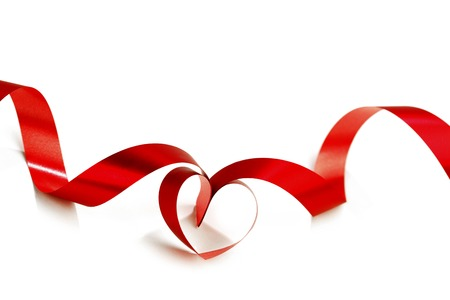 Heart from red ribbon isolated on white background photo