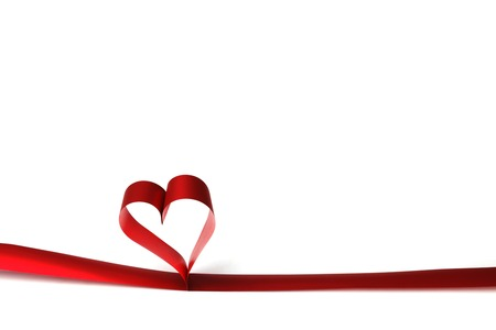 Heart shaped red ribbon isolated on white background photo