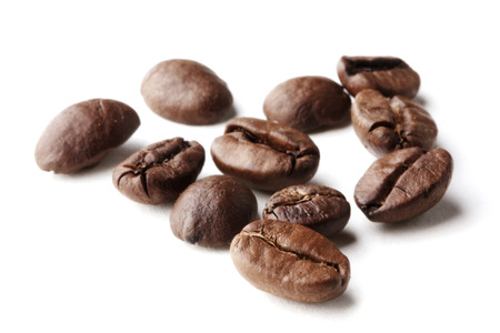 Roasted coffee beans isolated on white background close-up photo