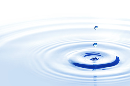 surface of the water: Blue water drops falling down close up