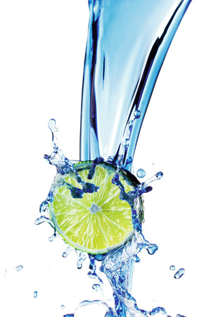 Fresh lime with water splash isolated on white background photo