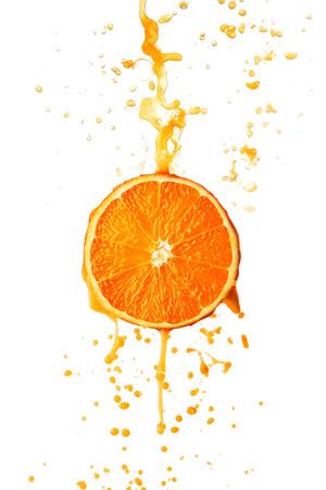 Orange juice splashing on slice isolated on white background photo