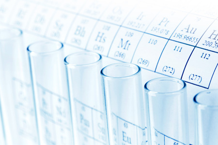 Test tubes and periodic table of elements, science concept photo