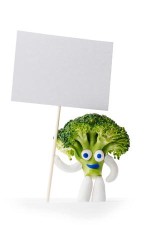 Broccoli mascot holding blank card isolated on white background photo